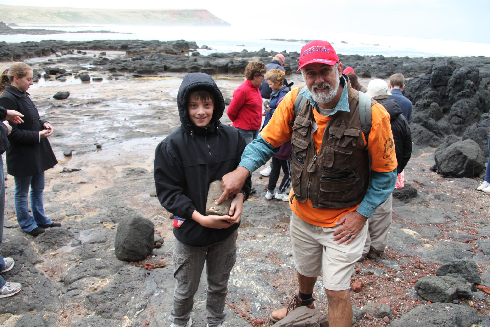 People holding a fossil